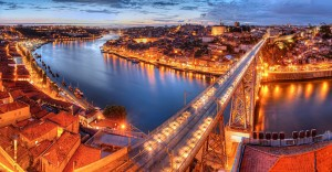 panorama-of-lighted-famous-bridge-ponte-dom-luis-above-old-town-porto-and-river-duoro-at-night-portugal-1600x831
